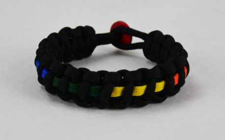 black lgbtq support paracord bracelet with rainbow line and red button in the back