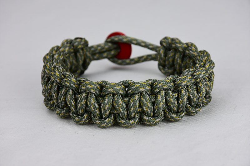 acu camouflage paracord bracelet unity band with red button back, picture of an acu camouflage paracord bracelet unity band with red button fastener in the back on a white background