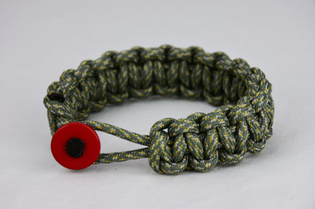acu camouflage paracord bracelet unity band with red button in front, picture of an acu camouflage paracord bracelet unity band with red button fastener in the front of a white background