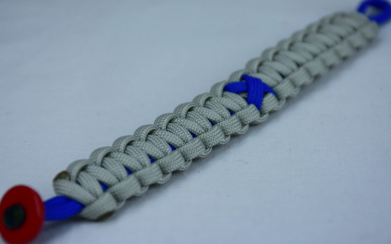 blue and grey anti bullying paracord bracelet with red button corner and blue ribbon