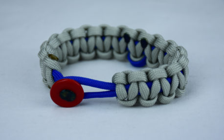 blue and grey anti bullying paracord bracelet with red button front and blue ribbon
