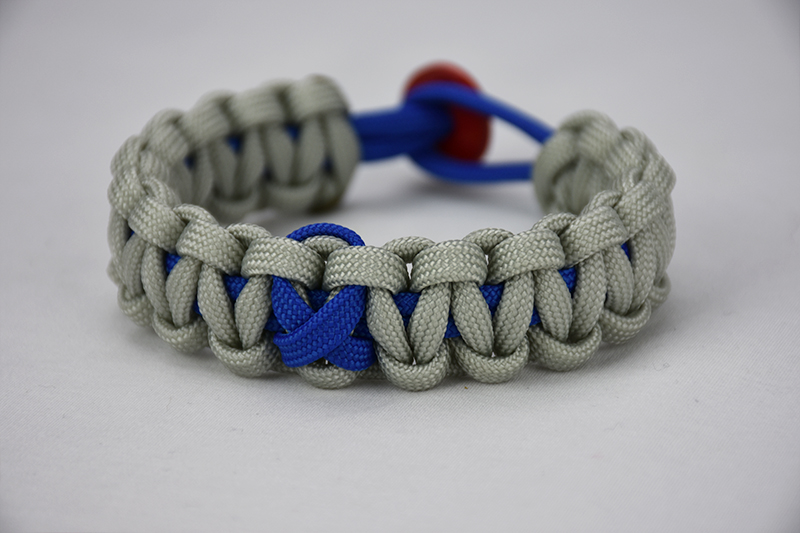 blue and grey anti-bullying paracord bracelet with blue and red button, blue and grey anti-bullying paracord bracelet with a blue ribbon and red button fastener unity band