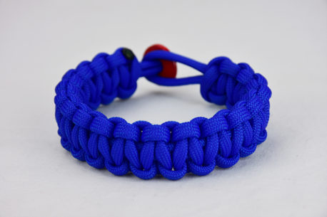 blue paracord bracelet unity band with red button, picture of a blue paracord bracelet with a red button fastener on a white background