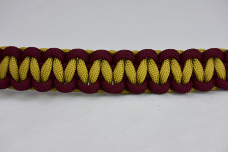 burgundy burgundy and gold paracord bracelet unity band across the center of a white background