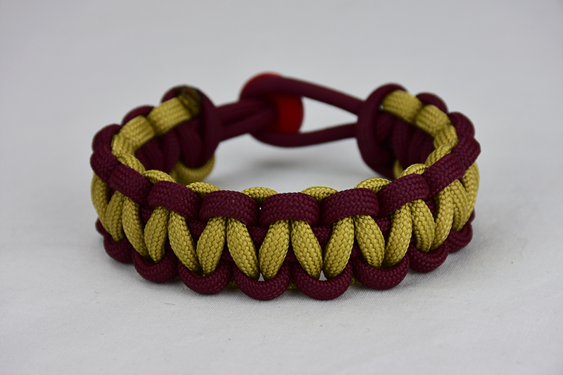 burgundy burgundy and gold paracord bracelet unity band with red button back, picture of a burgundy burgundy and gold paracord bracelet unity band with red button fastener in the back on a white background