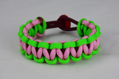 burgundy neon green and soft pink paracord bracelet unity band with red button back, picture of a burgundy neon green and soft pink paracord bracelet unity band with red button fastener on a white background