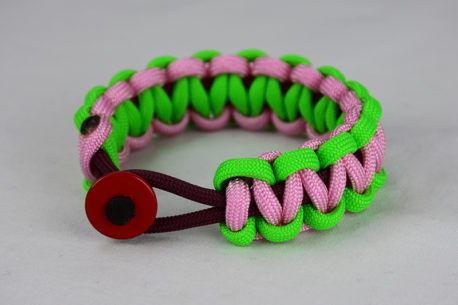 burgundy neon green and soft pink paracord bracelet unity band with red button in front, picture of a burgundy neon green and soft pink paracord bracelet unity band with red button fastener in the front on a white background