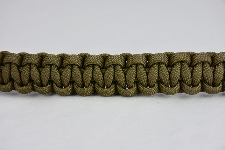 coyote brown paracord bracelet unity band, picture of a coyote brown paracord bracelet going across the center of a white background