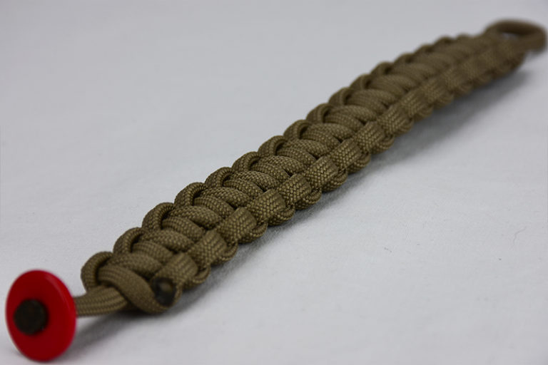 coyote brown paracord bracelet unity band with red button, picture of a coyote brown paracord bracelet with red button fastener in the front corner