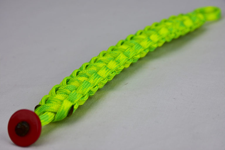 dayglow camouflage paracord bracelet unity band with red button in the front corner, picture of a dayglow camouflage paracord bracelet unity band with red button fastener in the front corner on a white background