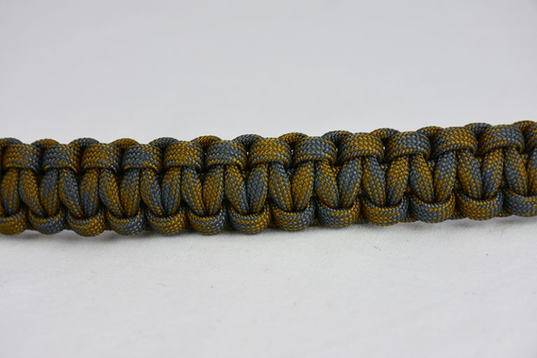 desert foliage camouflage paracord bracelet going across the middle of a white background