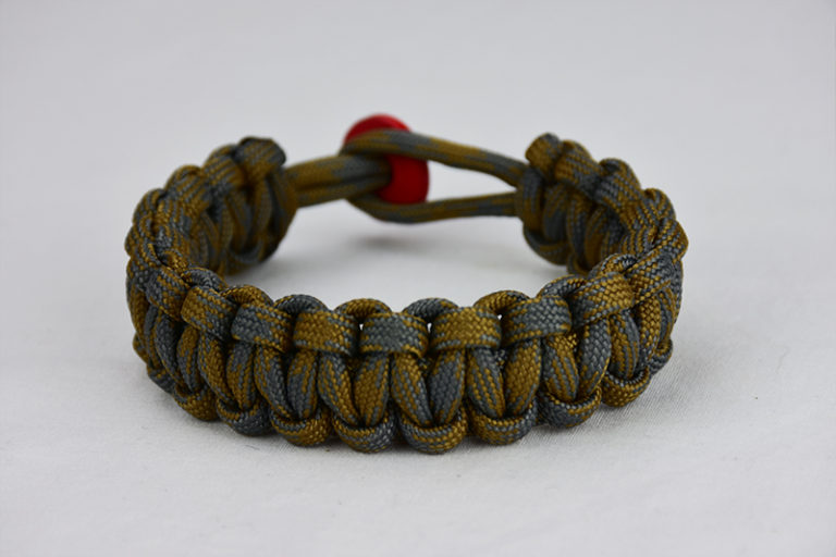 desert foliage camouflage paracord bracelet unity band with red button in back, picture of a desert foliage paracord bracelet unity band with red button fastener in the back