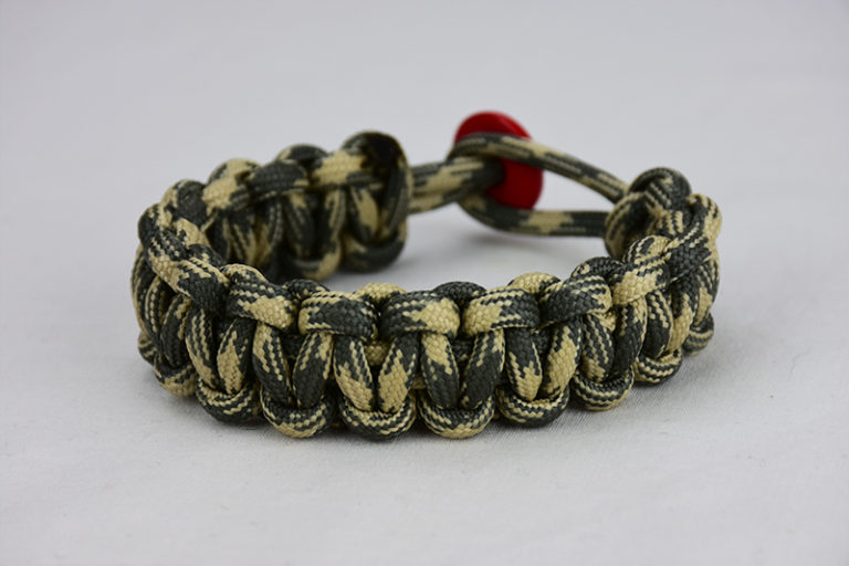 desert sand foliage camouflage paracord bracelet with red button in the back, picture of a desert sand foliage camouflage paracord bracelet with red button fastener in the back on a white background