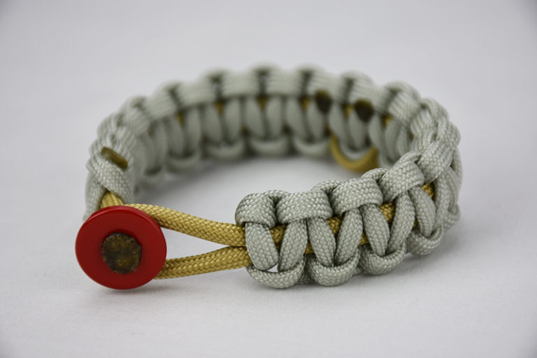 gold and grey pediatric cancer support paracord bracelet unity band, picture of a gold and grey pediatric cancer support paracord bracelet with a gold ribbon in the center and a red button fastener in the front