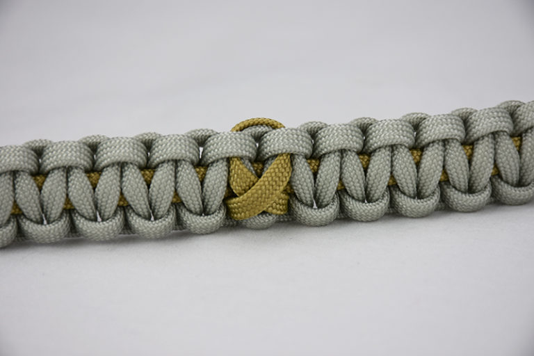 gold and grey pediatric cancer support paracord bracelet with gold ribbon in the center