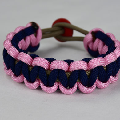 gold soft pink and navy blue paracord bracelet unity band with red button back, picture of a gold soft pink and navy blue paracord bracelet unity band with red button fastener in the back of a white background