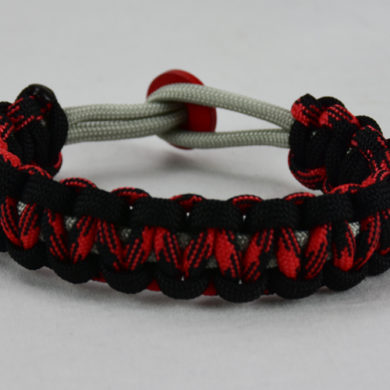 grey black red and black camouflage machine gun kelly paracord bracelet with red button in back