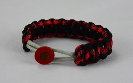grey black red and black camouflage machine gun kelly paracord bracelet with red button fastener in the front