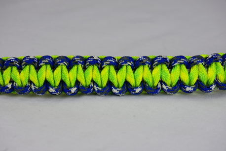grey blue camouflage and dayglow camouflage paracord bracelet unity band across the center of a white background