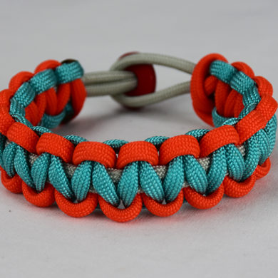 grey orange and teal paracord bracelet unity band with red button back, picture of a grey orange and teal paracord bracelet unity band with red button fastener on a white background