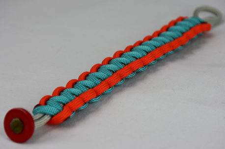 grey orange and teal paracord bracelet unity band with red button in the front corner on a white background