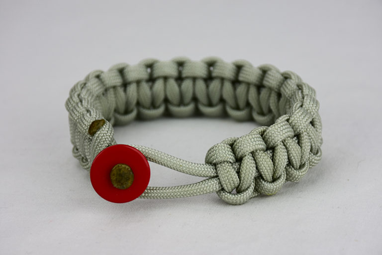 grey paracord bracelet unity band with red button front, picture of a grey paracord bracelet unity band with red button fastener in the front on a white background