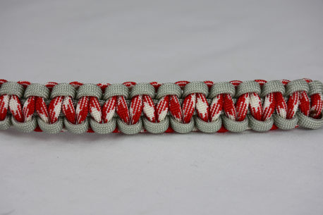 grey red and white camouflage and grey paracord bracelet unity band across the center of a white background