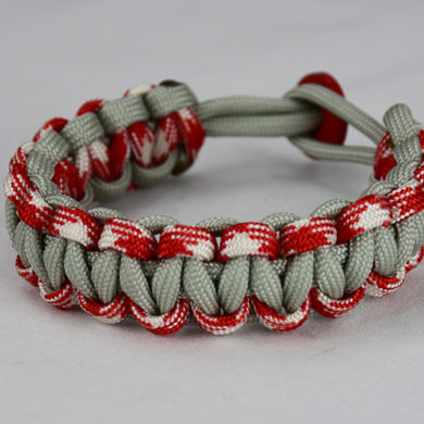 grey red and white camouflage and grey paracord bracelet unity band with red button back, picture of a grey red and white camouflage and grey paracord bracelet unity band with red button fastener on a white background