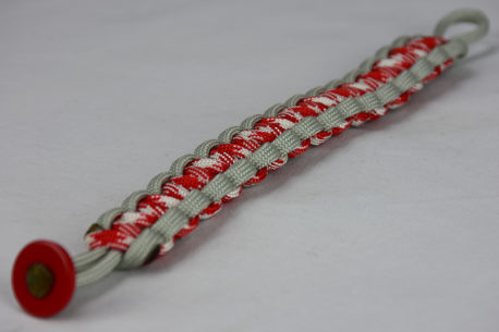 grey red and white camouflage and grey paracord bracelet unity band with red button corner on a white background
