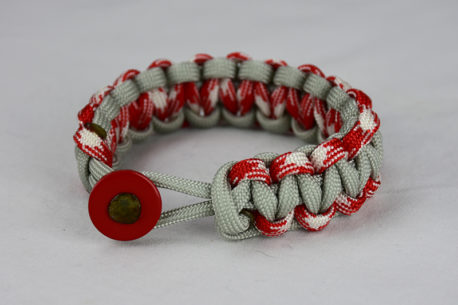grey red and white camouflage and grey paracord bracelet unity band with red button front on a white background