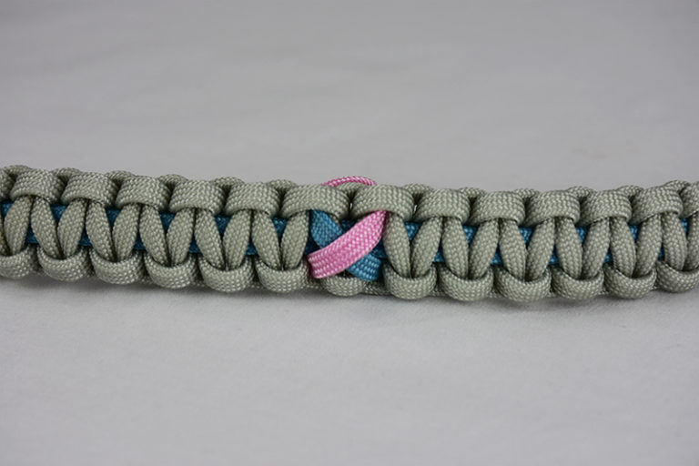 light blue and grey sids support paracord bracelet across the center of a white background, light blue and grey sids support paracord bracelet with light blue and pink sids ribbon