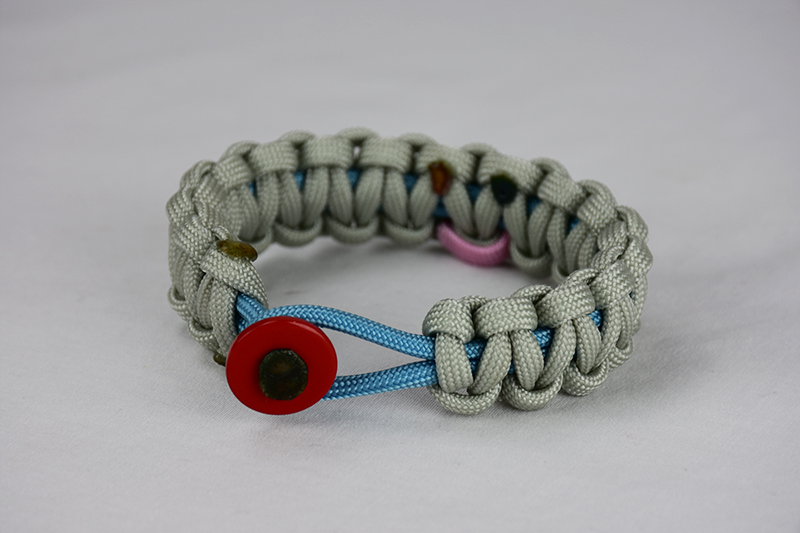 light blue and grey sids support paracord bracelet unity band with red button in the front, picture of a light blue and grey sids support paracord bracelet with red button fastener in the front on a white background