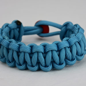 light blue paracord bracelet unity band with red button in back, picture of a light blue paracord bracelet unity band with red button fastener in the back on a white background