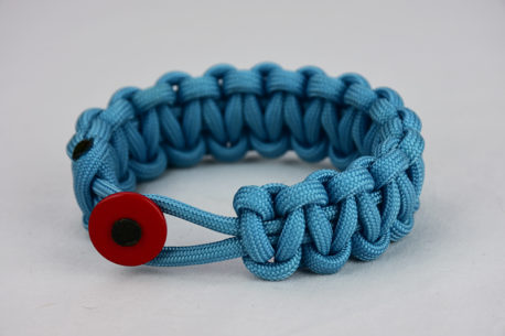 light blue paracord bracelet unity band with red button in front, picture of a light blue paracord bracelet unity band with red button fastener on a white background