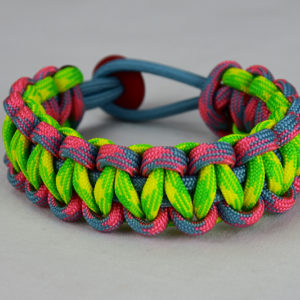 light blue pink and light blue camouflage and dayglow camouflage paracord bracelet with red button in the back on a white background