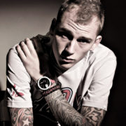 machine gun kelly wearing his unity band paracord bracelet on the cover of cleveland scene magazine