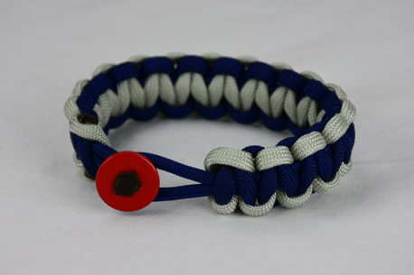 navy blue grey and navy blue paracord bracelet unity band with red button on a white background