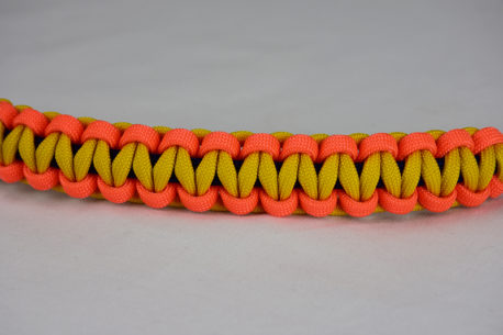 navy blue neon orange and yellow paracord bracelet unity band across the center of a white background