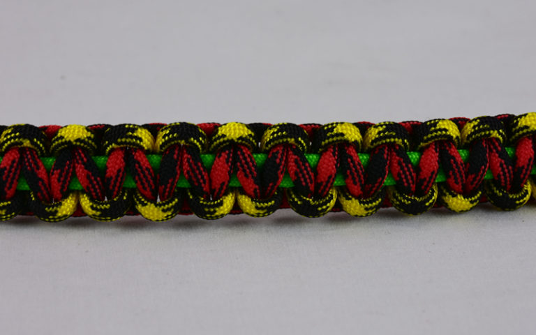 neon green black and yellow camouflage red and black camouflage rasta paracord bracelet across the center