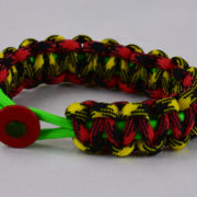 neon green black and yellow camouflage red and black camouflage rasta paracord bracelet red button front
