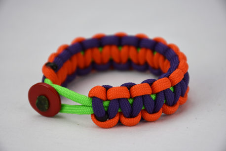 neon green orange and purple paracord bracelet unity band with red button in the front