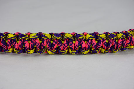 neon yellow purple and yellow camouflage pink and purple camouflage paracord bracelet unity band across the center of a white background