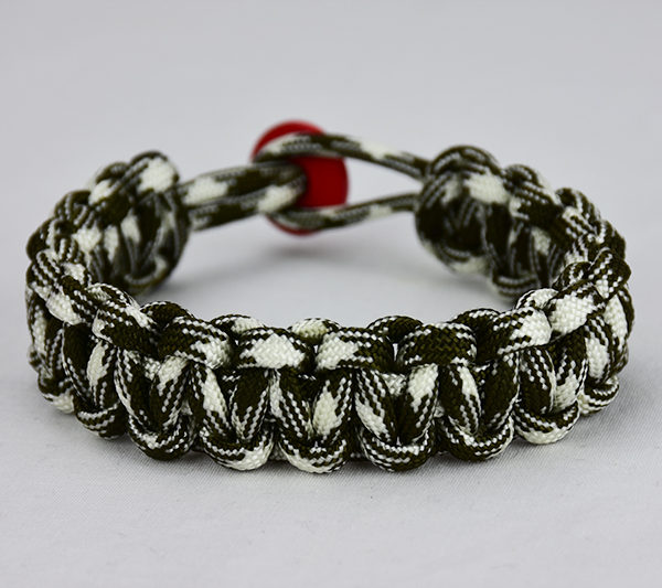 od green and white camouflage paracord bracelet unity band with red button back, picture of an od green and white paracord bracelet unity band with red button fastener in the back on a white background