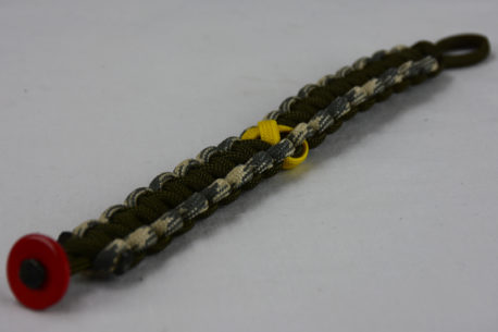 od green desert sand foliage camouflage and od green military support paracord bracelet with red button fastener in the corner and yellow ribbon