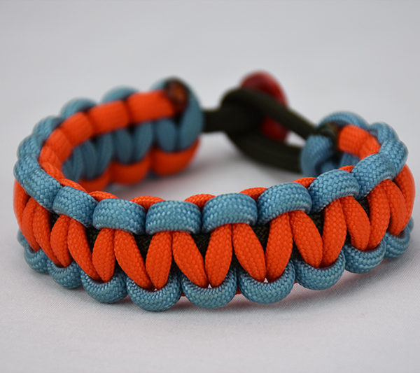 od green light blue and orange paracord bracelet unity band with red button, picture of a od green light blue and orange paracord bracelet with red button fastener on a white background, multi color paracord bracelet
