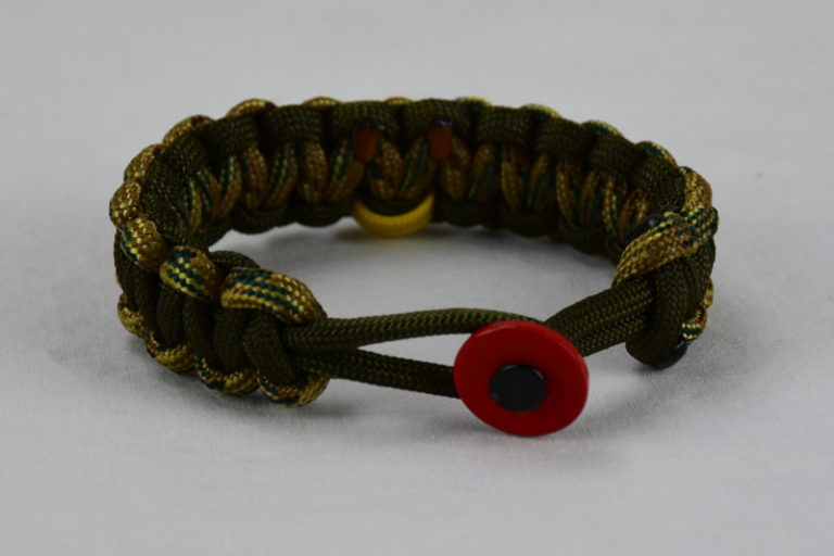 od green multicam camouflage and od green military support paracord bracelet with red button fastener in front and yellow ribbon