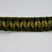 od green od green multicam camouflage paracord bracelet unity band across the center of a white background
