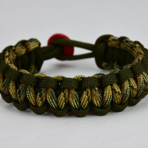 od green od green mulitcam camouflage paracord bracelet unity band with red button in the back, picture of an od green od green mulitcam camouflage paracord bracelet unity band with red button fastener in the back on a white background