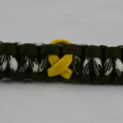 od green od green and od green and white camouflage military support paracord bracelet with yellow ribbon in the center