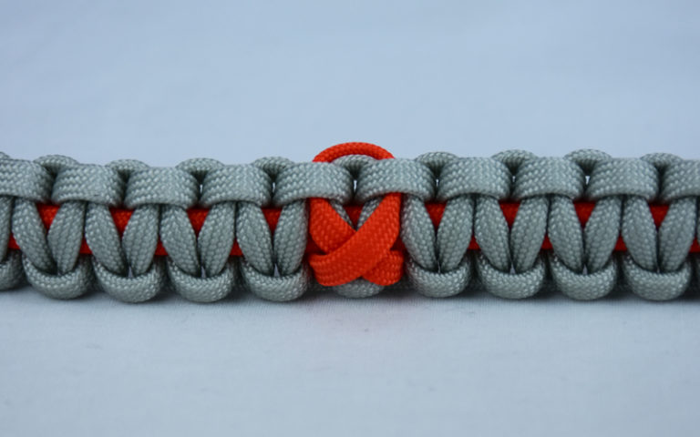 orange and grey leukemia support paracord bracelet with orange ribbon center